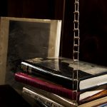Rope ladder and books